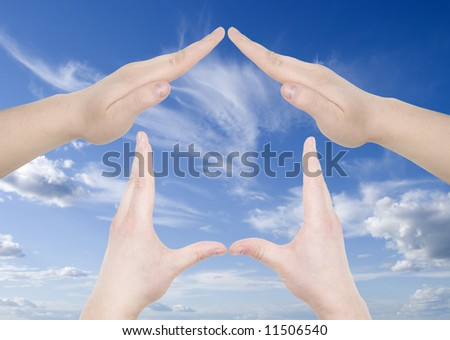hand home gesture over sky background