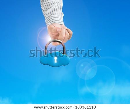 Hand hooking cloud shape lock with sun light blue sky background - stock photo
