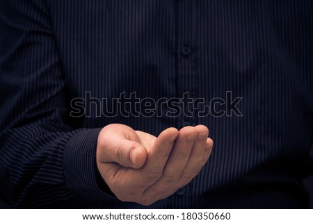 Hand in a gesture of holding something or ask for help - stock photo
