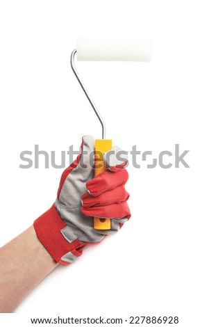 Hand in a red working glove, holding a paint roller, composition isolated over the white background