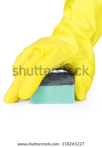 Hand in a rubber glove cleaning a white surface with a sponge.