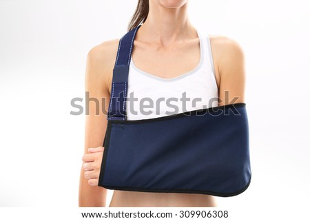 Hand in a sling. Woman with hand in the dressing orthopedic - stock photo