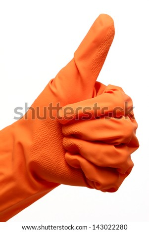 Hand in an orange cleaning or protection glove making an OK approval sign on white background. - stock photo