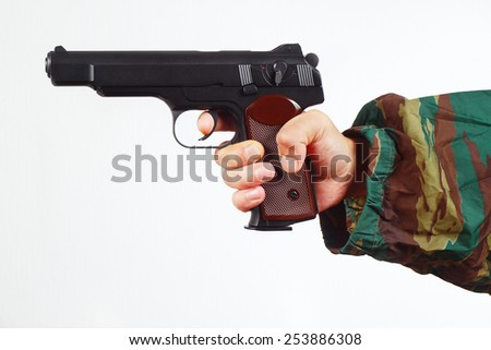 Hand in camouflage uniform with army gun on a white background - stock photo