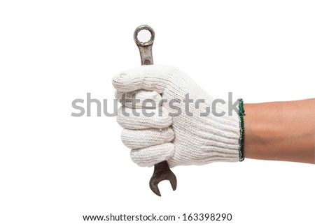 Hand in glove holding a spanner isolated on a white background with using path  - stock photo