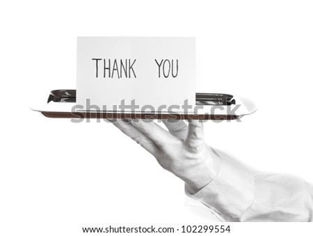 Hand in glove holding silver tray with card saying thank you isolated on white - stock photo