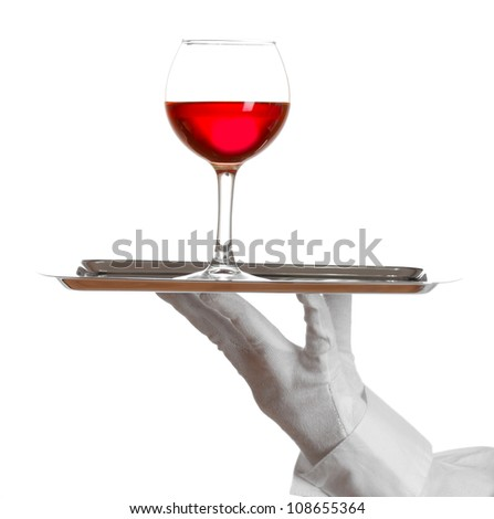 Hand in glove holding silver tray with wineglass isolated on white - stock photo