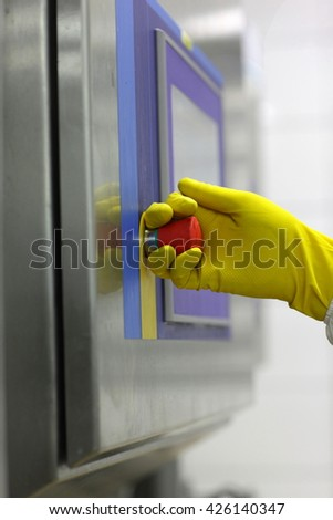 hand in glove pulling  technology lever at control panel