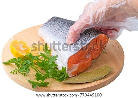 Hand in glove with the transparent steak red fish isolated on white background