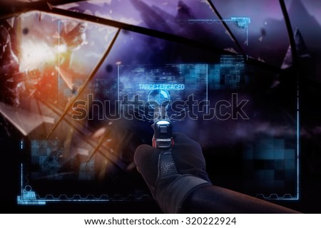 Hand in gloves holding a pointing straight handgun. First person view hand in black leather gloves holding a futuristic fantasy neon pointing straight handgun with neon red, blue indicator panels. - stock photo