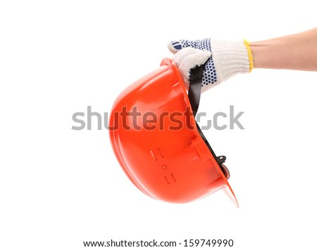 Hand in gloves holds hard hat. Isolated on a white backgropund.