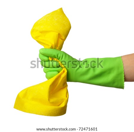 Hand in green rubber glove holds a yellow rag - house cleaning concept, isolated over white