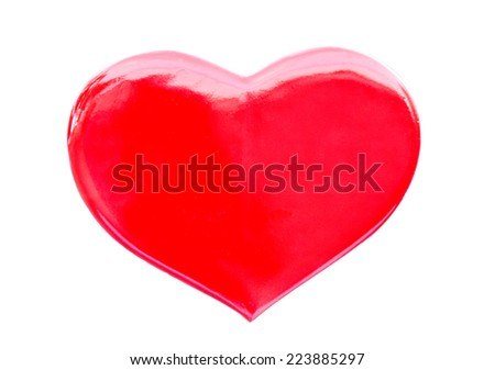hand in hand with red heart and blur background