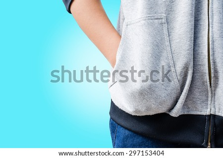 Hand in his pocket shirt on blue background.