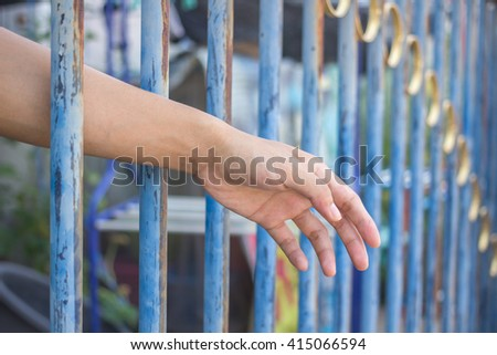 hand in jail,concept hope and freedom. - stock photo