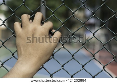 Hand In Jail, concept of life imprisonment, Abstract background concept of life imprisonment. - stock photo