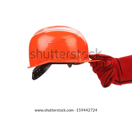 Hand in leather gloves holds hard hat. Isolated on a white backgropund.