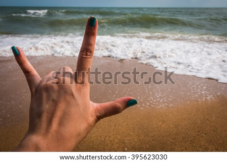 Hand in love you for background at the sea - stock photo