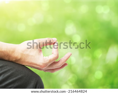 hand in meditation on a green background