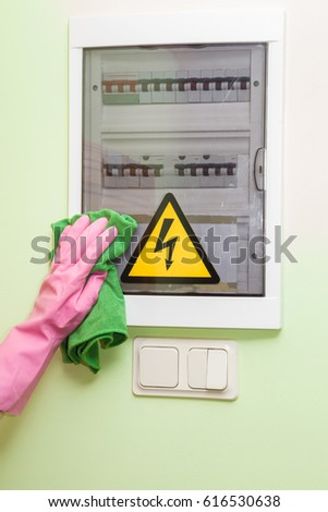 stock photo hand in pink protective glove with rag wiping a electricity fuse box early spring cleaning or 616530638 home fuse box stock images, royalty free images & vectors fuse box cleaner at couponss.co