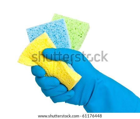Hand in rubber glove holding washing up sponges on white background