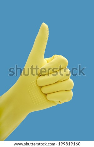 Hand in rubber gloves gesturing okay, close up - stock photo