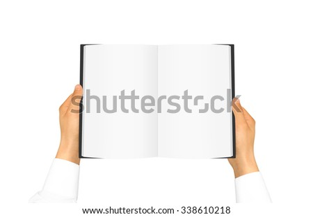 Hand in white shirt sleeve holding blank book in the hand. Black cover brochure presentation. Pamphlet hand man. Man show pages. Sheet template. Booklet in hands. Book design. Catalog sheet display. - stock photo