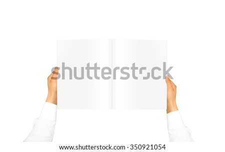 Hand in white shirt sleeve holding blank journal in the hand. Empty magazine presentation. Pamphlet hand man. Man show pages. Sheet template. Booklet in hands. Book design. Catalog sheet display. - stock photo
