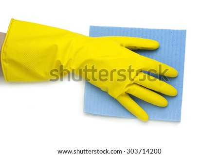 hand in yellow glove with blue cloth on a white background
