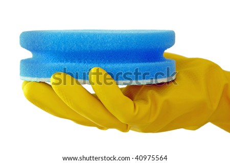 Hand in yellow household glove holding a blue sponge scrub isolated against a white background - stock photo