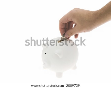 Hand inserting a coin in the piggy bank