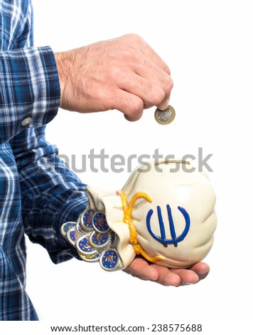 Hand inserting a coin in to a sack money box against white background - stock photo