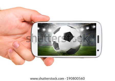 hand is holding a modern phone with soccer or football ball on screen - stock photo