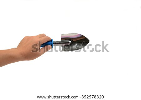 Hand is holding a shovel isolated on white - stock photo