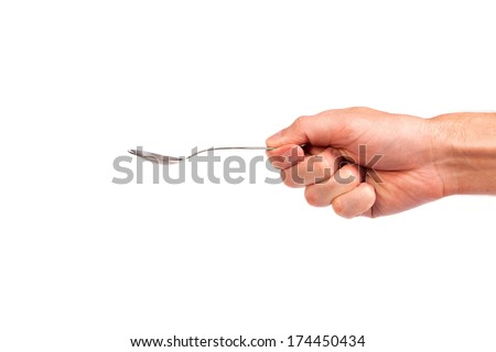 Hand is holding a spoon isolated on a white background