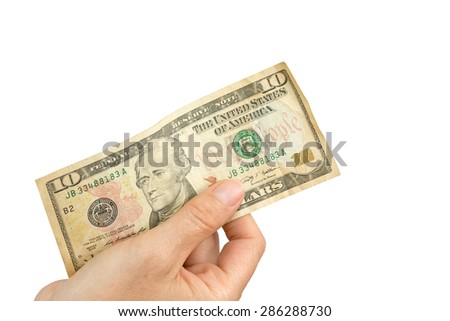 Hand is holding a ten US dollar note. Isolated on the white background.