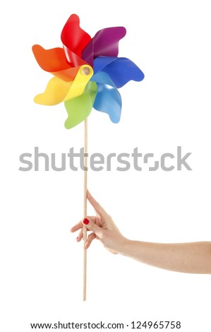 Hand is holding colorful pinwheel toy - stock photo