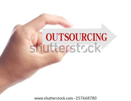 Hand is holding Outsourcing arrow isolated on white background. - stock photo