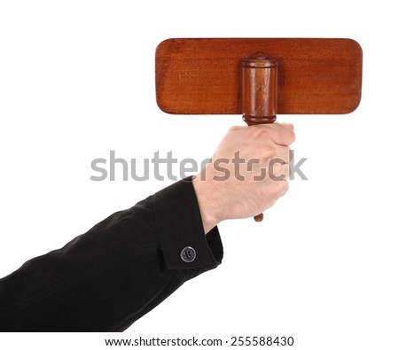Hand is holding wooden sign board bid paddle - stock photo