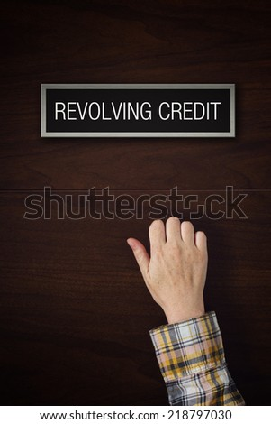Hand is knocking on Revolving Credit door, conceptual image. - stock photo