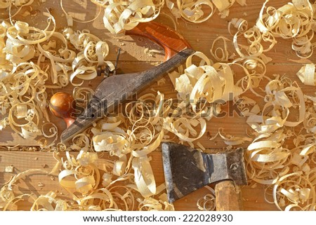 Hand jack plane, axe and wood chips  - stock photo