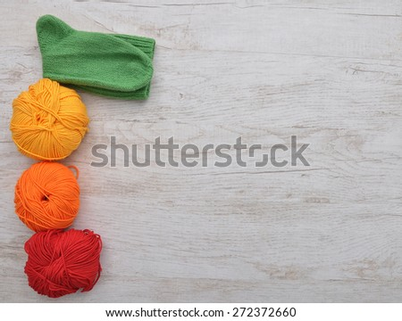 Hand-knitted sock and wool - stock photo