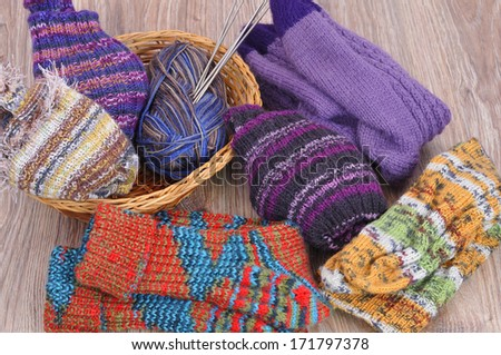 Hand-knitted socks. - stock photo
