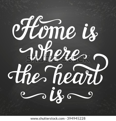 Hand lettering typography poster. Calligraphic script 'Home is where the heart is' .For posters, cards, home decorations, t shirt, wooden signs.Romantic quote. - stock photo
