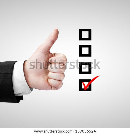hand like and checklist on a gray background - stock photo