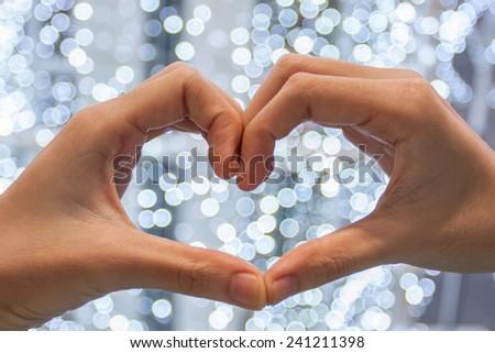 hand love heart and bokeh,love ,valentine concept. - stock photo