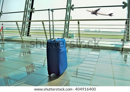 hand luggage forgot at the airport lobby - stock photo