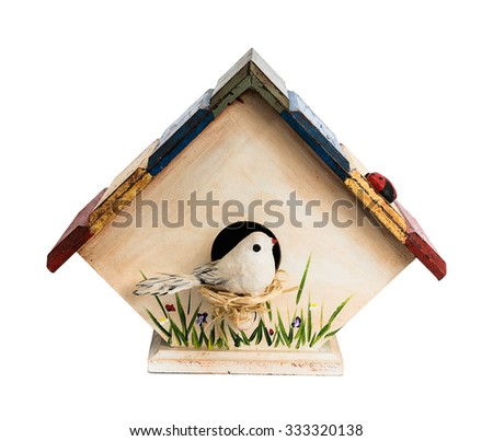 Hand made birdhouse with bird, grass and flowers painted on walls, isolated on white - stock photo