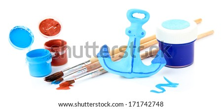Hand made ceramic anchor and color paints isolated on white