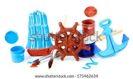 Hand made ceramic toys and color paints isolated on white - stock photo